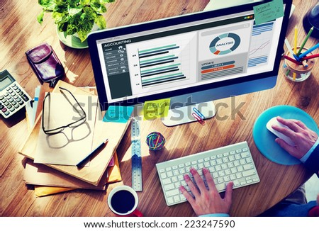 Man Working in the Office Regarding Accounting - stock photo