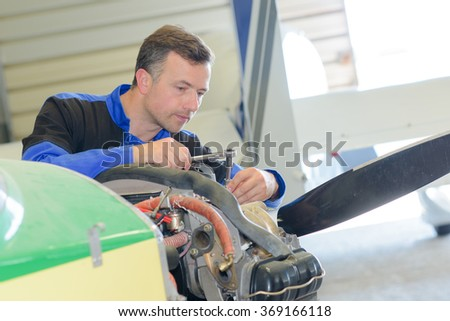 Man working on aircraft - stock photo