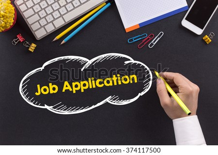 Man working on desk and writing Job Application - stock photo
