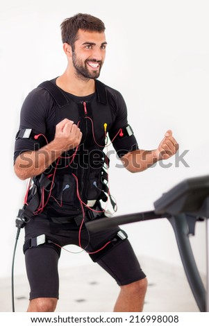 man working on electro muscular stimulation machine - stock photo