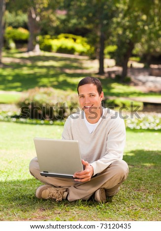 Man working on his laptop in the park
