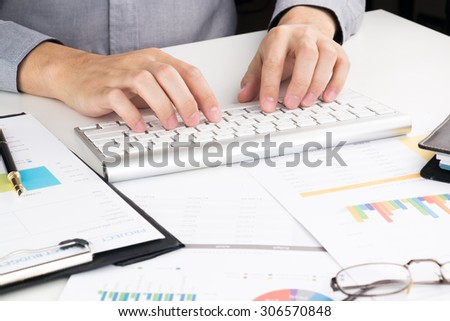man working on his office desk - stock photo