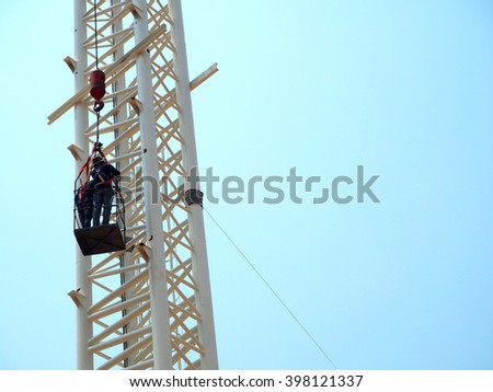Man Working on the Working at height,sign board,crane,Lifting and moving
