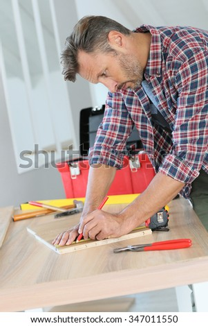 Man working on wood planks for home-improvement