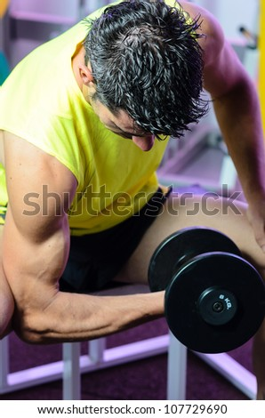 Man working out biceps dumbbell training. Man lifting weights. - stock photo