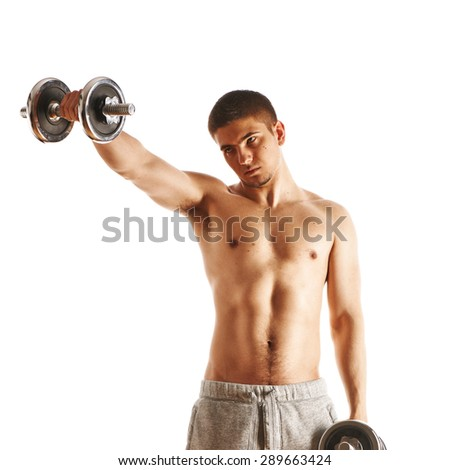 Man working out with dumbbells on white background - stock photo