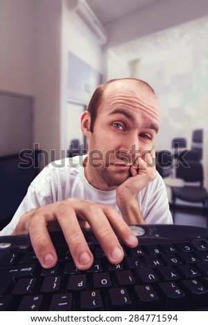 Man working with computer - stock photo