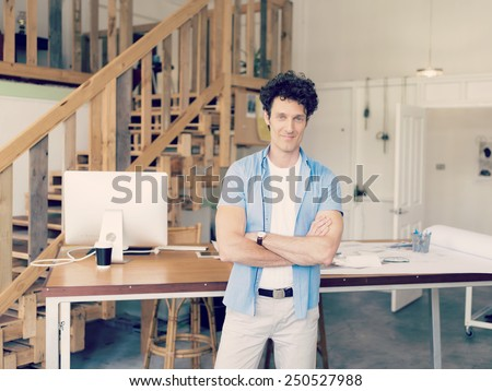 Man working with drafts in office - stock photo