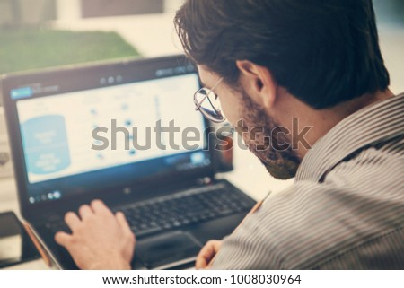 Man working with laptop in design studio