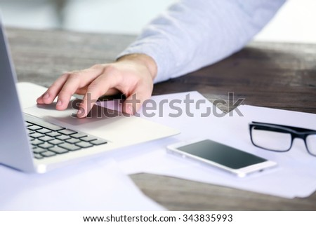 Man working with laptop in office