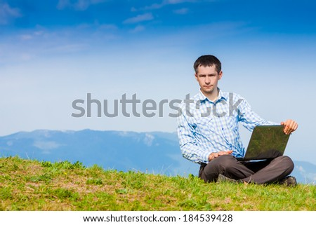 Man working with laptop outdoor