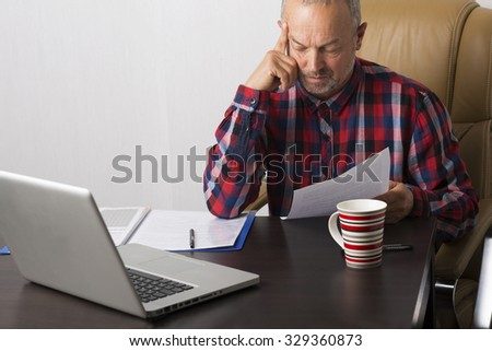 Man working with papers in the office