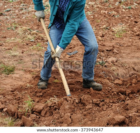 man working with spade