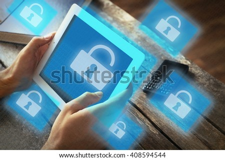 Man working with tablet-pc and icons security on virtual display. Technology, internet and networking concept. - stock photo