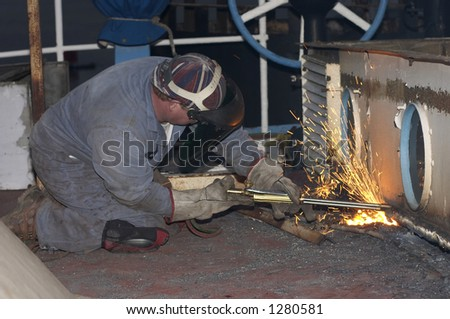 man working with torch