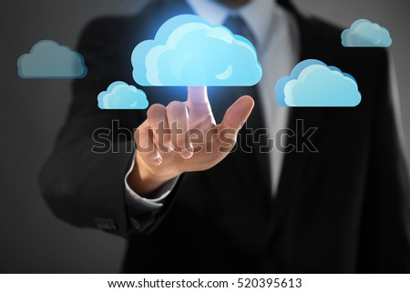 Man working with virtual screen, closeup. Cloud storage concept.