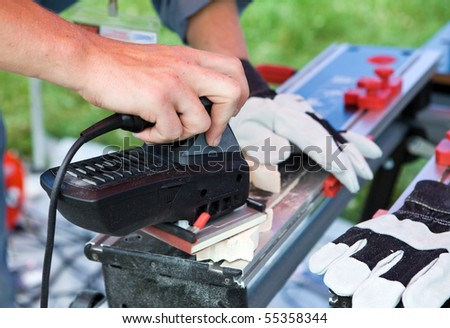 Man works with polishing machine - stock photo