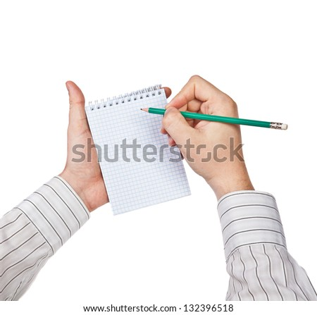 Man writes in a notebook - stock photo