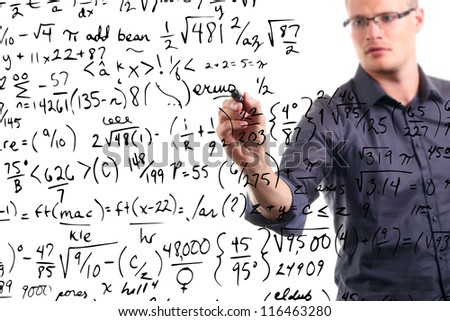 man writes mathematical equations on whiteboard - stock photo