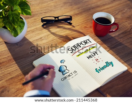 Man Writing and Planning Customer Service Concepts - stock photo