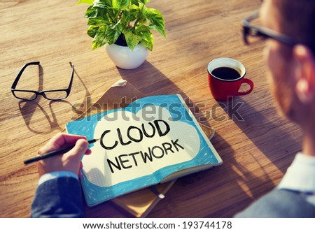 Man Writing Cloud Network Concepts on His Note - stock photo