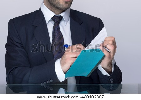 Man writing down in a notebook