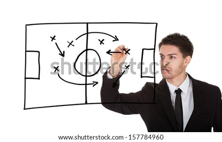 Man writing football game strategy on white screen - stock photo