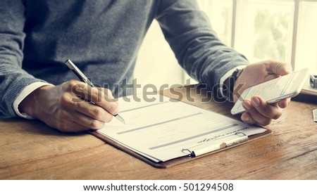 Man Writing Insurance Application Form Concept