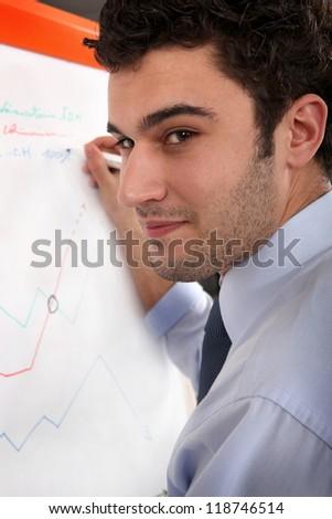 Man writing on a flip chart - stock photo