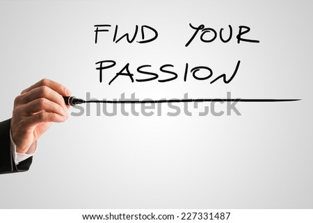 Man writing the idiom - Find your passion - on a virtual interface with a black marker pen over grey with copyspace in a motivational message.
