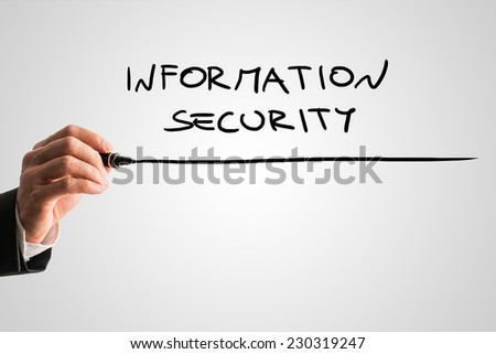 Man writing the word Information security on a virtual screen or interface with a black marker over a light grey background with copyspace.