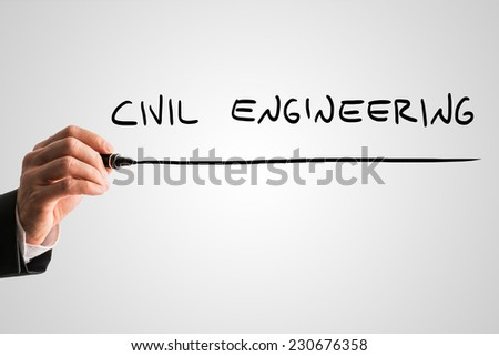 Man writing the words Civil engineering with a black marker pen from behind a virtual screen or interface on a light grey background with copyspace, close up view of the text and his hand.