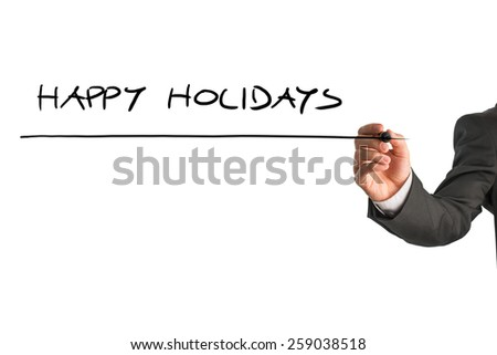Man writing the words - Happy holidays - with a black marker pen from behind a virtual screen or interface on a light grey background with copyspace, close up view of the text and his hand. - stock photo