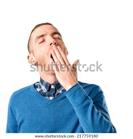 Man yawning over isolated white background - stock photo