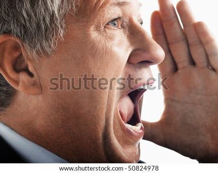 Man yelling, side view close-up - stock photo