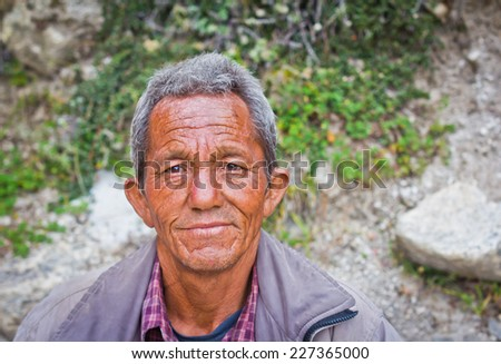 Mana village, India - October 1, 2014: A poor man with sad face from small village in Himalayas. Idea - Poverty concept. - stock photo