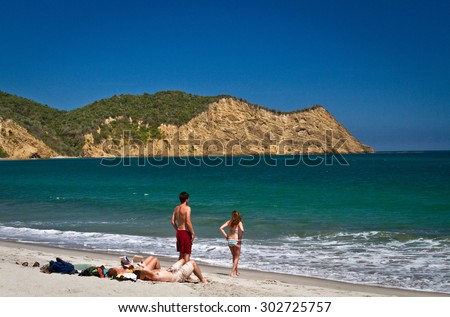 MANABI, ECUADOR - JUNE 2, 2012: Unidentified tourists enjoying the ecological Los Frailes beach, known to be the most beautiful beach in Ecuador. Machalilla National Park preserve, Manabi, Ecuador