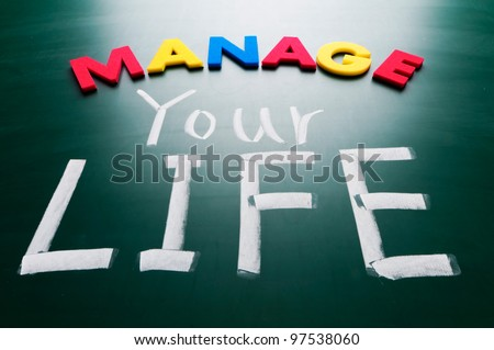 Manage your life, colorful conceptual words on blackboard.