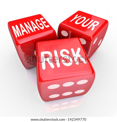Manage Your Risk in a dangerous world, company, workplace or enterprise by reducing costs and liability, illustrated by these words on three red dice - stock photo