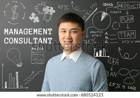 Management consultant and drawing on black background
