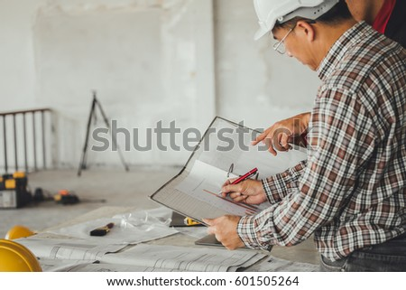 Management consulting engineers foreman working blueprint stock management consulting with engineers working with blueprint and drawing on work table in for management business malvernweather Choice Image
