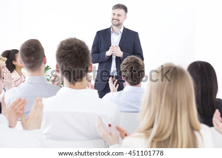 Management leader making a speech about company's strategy during business meeting in a corporation - stock photo