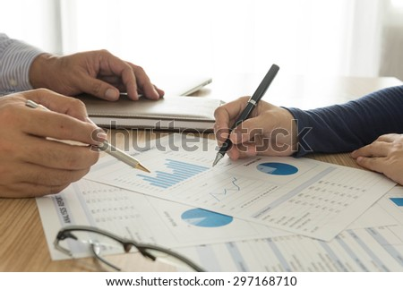 manager analyze financial numbers to view the performance of the company. - stock photo
