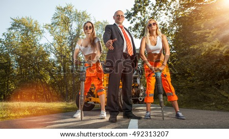 Manager and two women workers with the jackhammers.