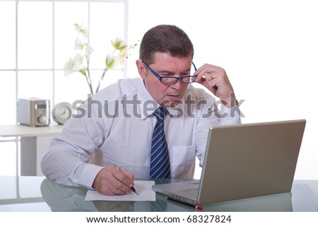 manager at work in white office - stock photo
