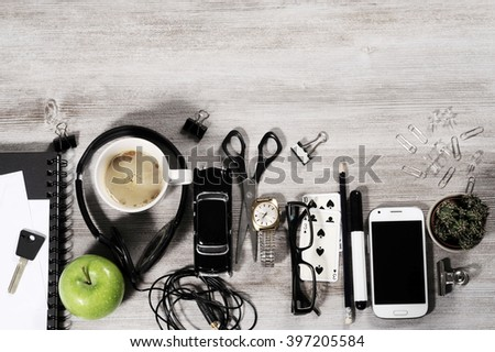 manager business tabletop with office objects on a wooden table - stock photo