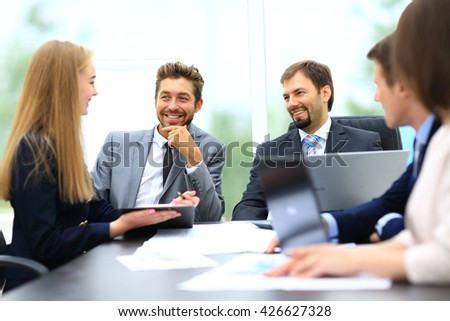 manager discussing work with his colleagues - stock photo