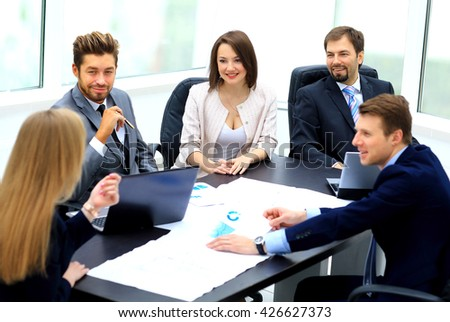 manager discussing work with his colleagues