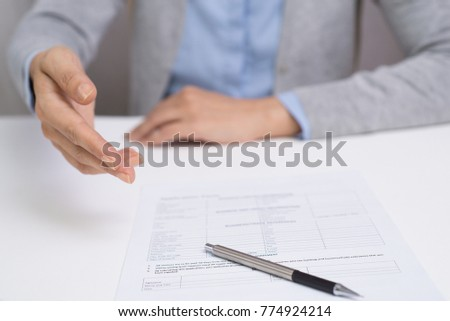 Manager explaining contract contain to customer