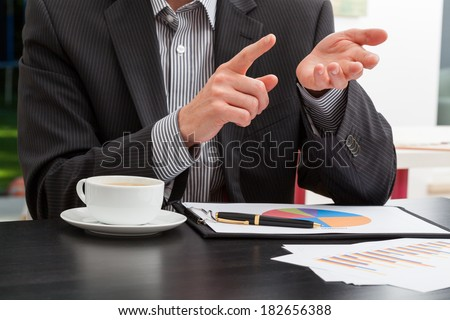 Manager explaining issues at the business meeting - stock photo